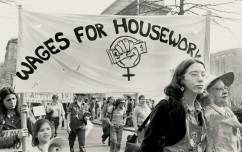 Demonstrators march under the Wages for Housework banner on International Women's Day, 1977. (Photo by Bettye Lane/ Schlesinger Library on the History of Women in America, Radcliffe Institute)